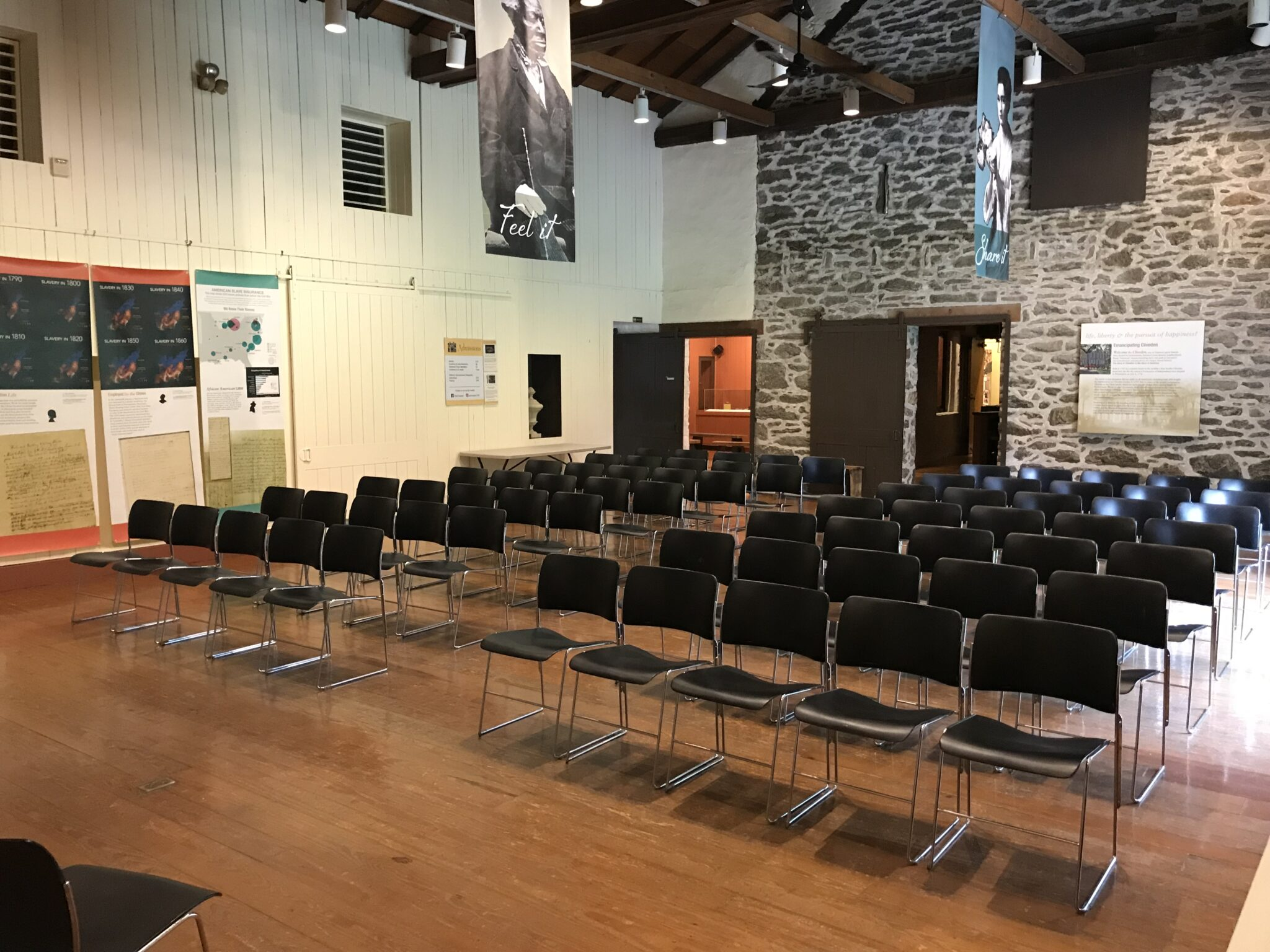 Room with chairs set up for lecture/performance