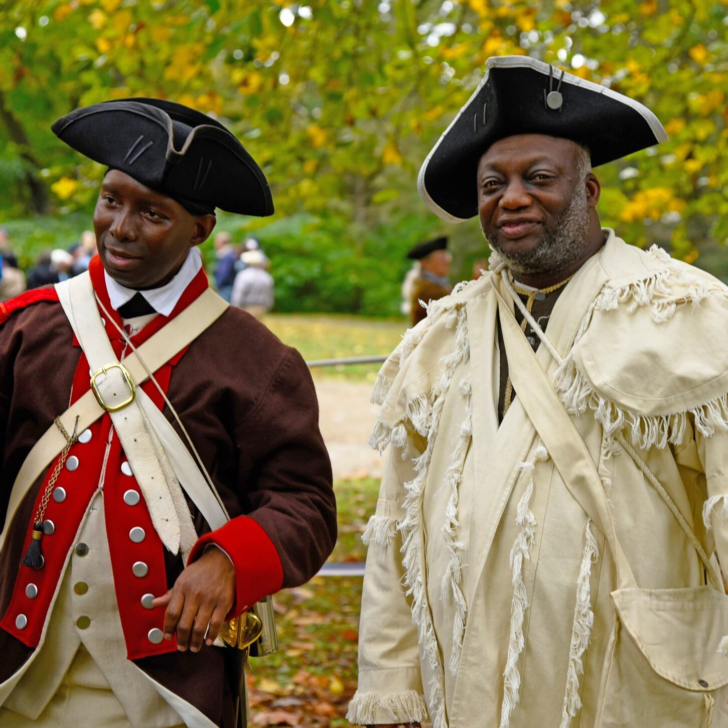 Two men pose for photograph while participating in a Revolutionary War Reinactment